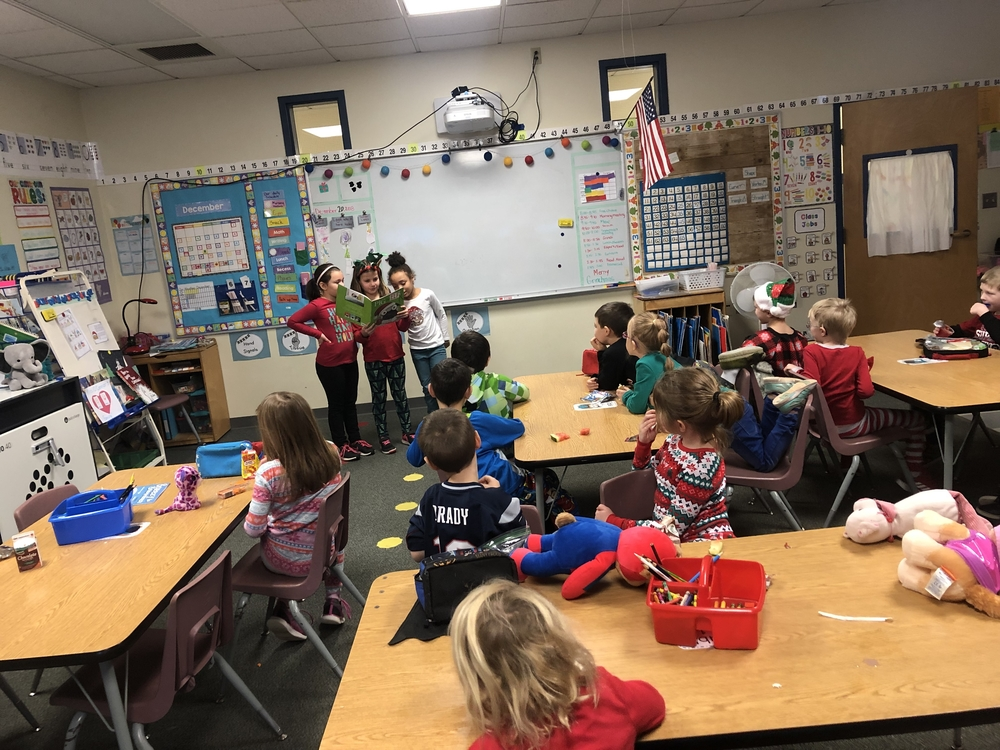 Kindness Club reads holiday stories to kindergarten classes!