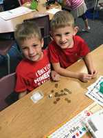 First Graders in Mrs. Giberti's Class Play the Penny Dice Game