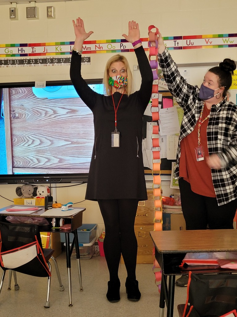 Ms. Thomson's class paper chain measured next to Mrs. Hallissey.