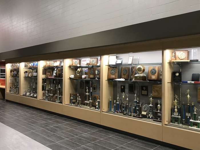 Sports trophy case outside competition gym