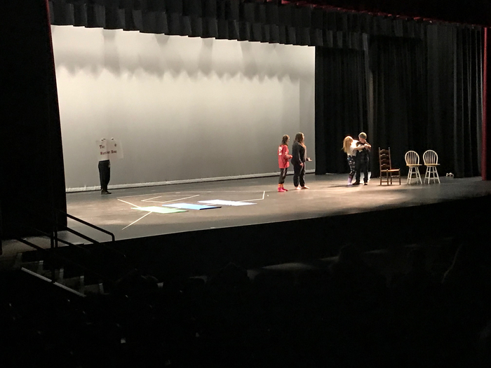 Ms. Clark's drama class performing their finals on the stage