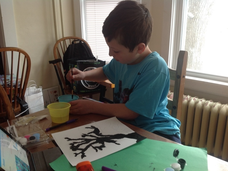 5th Grader William works on a painting for his Distance Art Learning